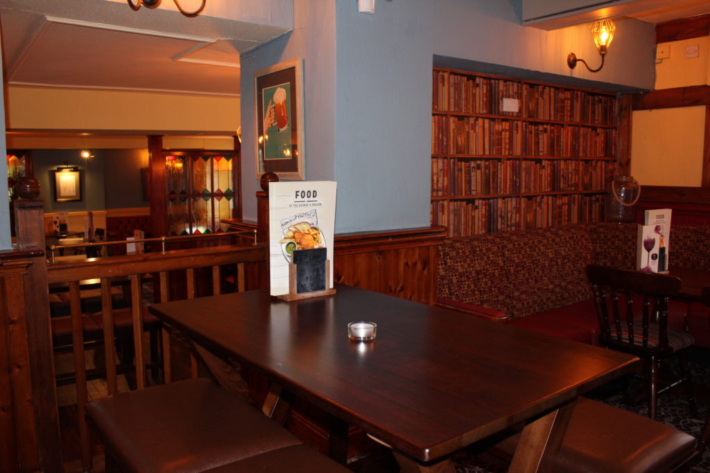 Pub interior and dining tables at The George and Dragon pub at at Glazebury.