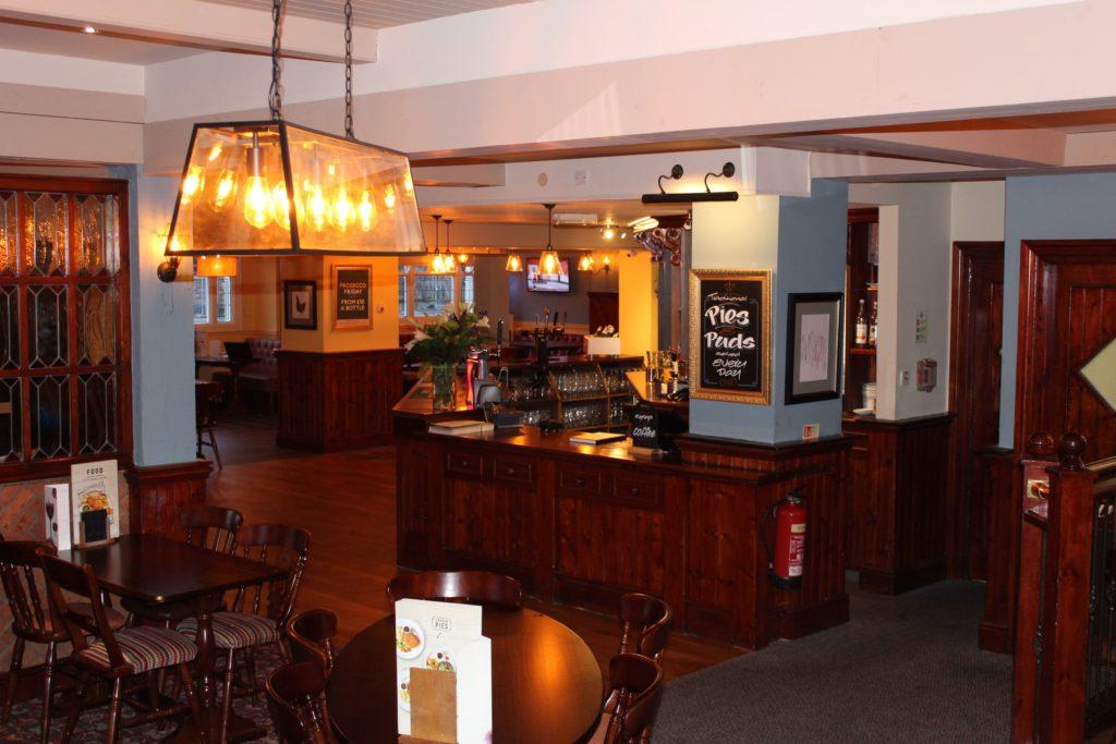 Pub interior and bar at The George and Dragon pub at at Glazebury.
