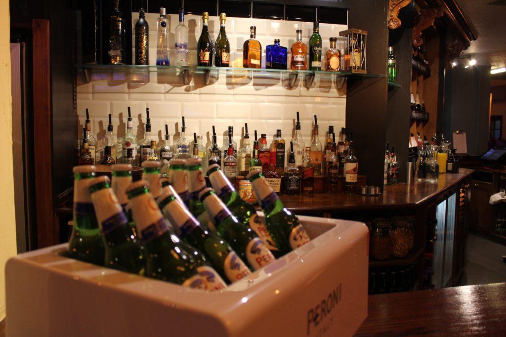bar and peroni bottles at The George and Dragon pub at at Glazebury.
