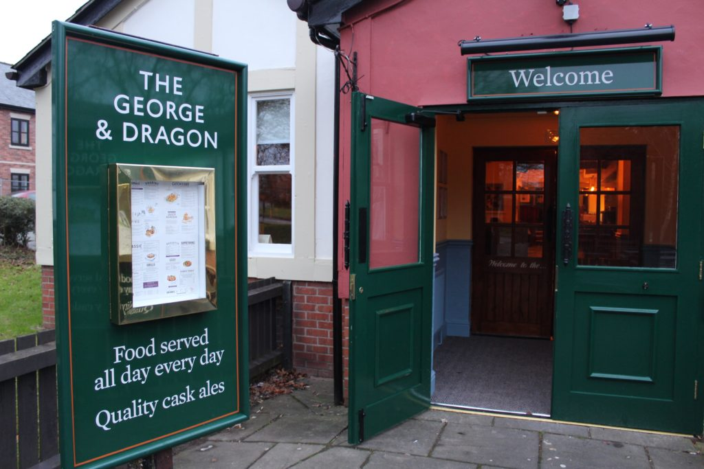 Entrance to The George and Dragon pub at at Glazebury.