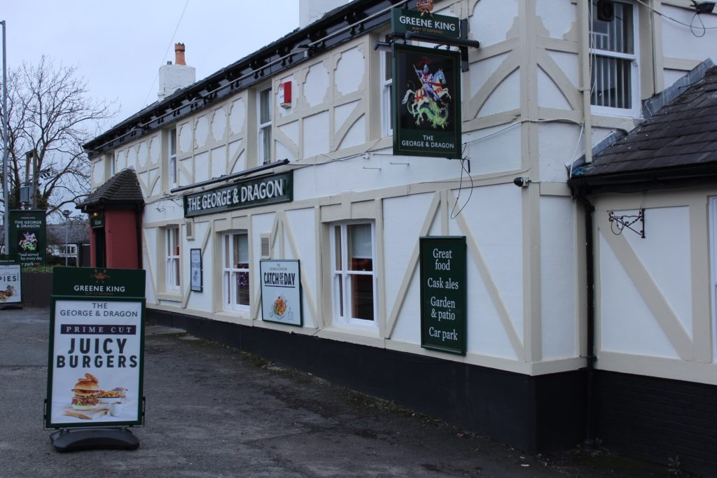 Exterior of The George and Dragon pub at at Glazebury.