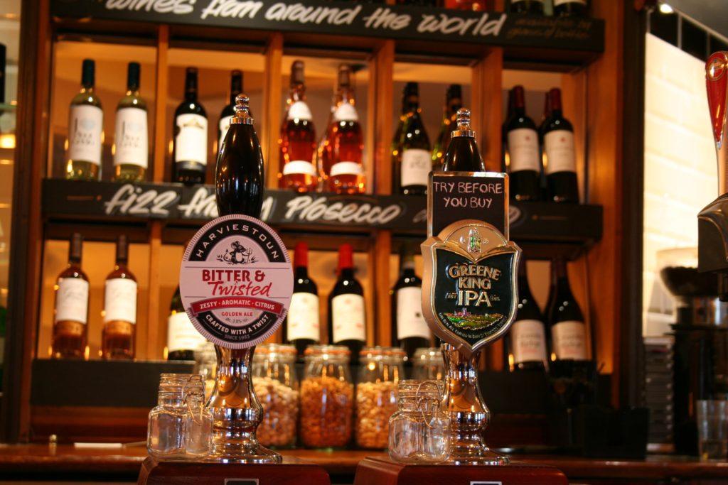 Harvistoun and greene king IPA beer fonts at The George and Dragon pub at at Glazebury.